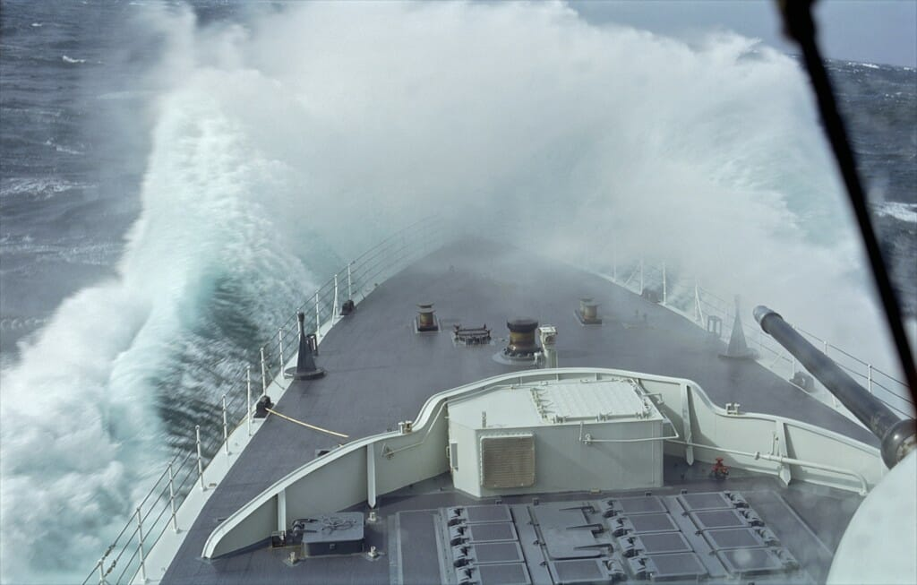 Destroyer HMCS Athabaskan plunges into heavy swells. From Rescue.