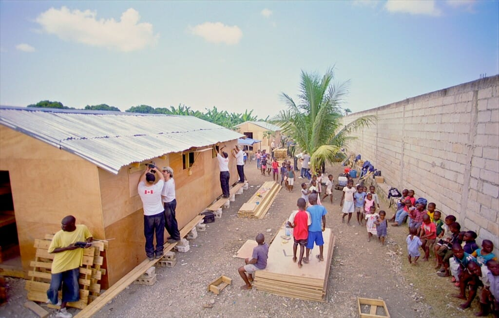 "Navy personnel build temporary facilities on the ground in Haiti. Image from the giant screen film ""Rescue""."