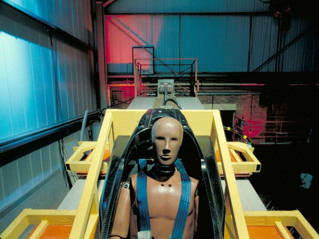 A crash test dummy prepares for the worst during crash testing of an Indy car nose cone.