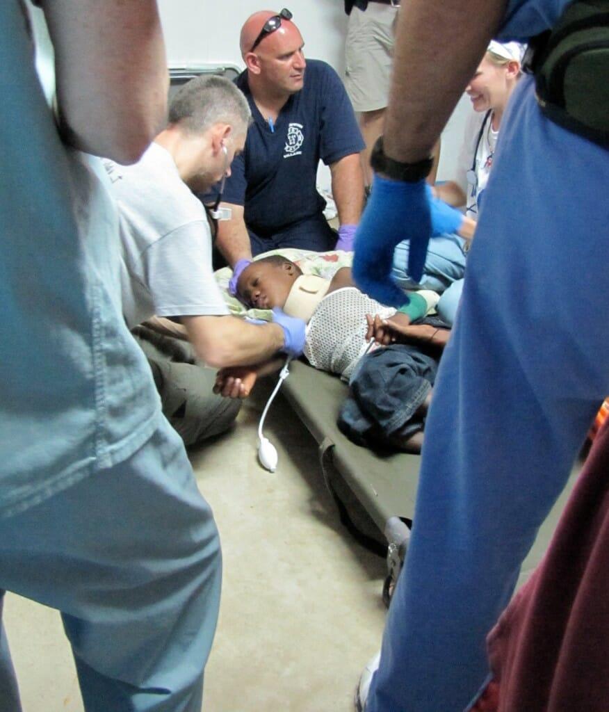 Rescue workers attend an injured child. (Steven Heicklen rear center).